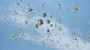 Virus flotando en gotas sobre fondo de cielo azul